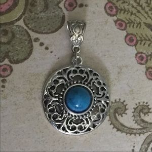 Silver and turquoise round pendant